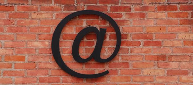 at symbol on brick wall